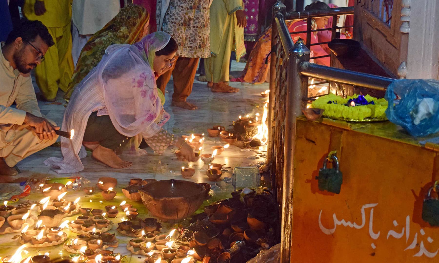 Women light earthen lamps for the prayers they are seeking from God. It is known as *mannat* in the spiritual order and only those can touch the lamps who have some desire or prayer to be fulfilled.