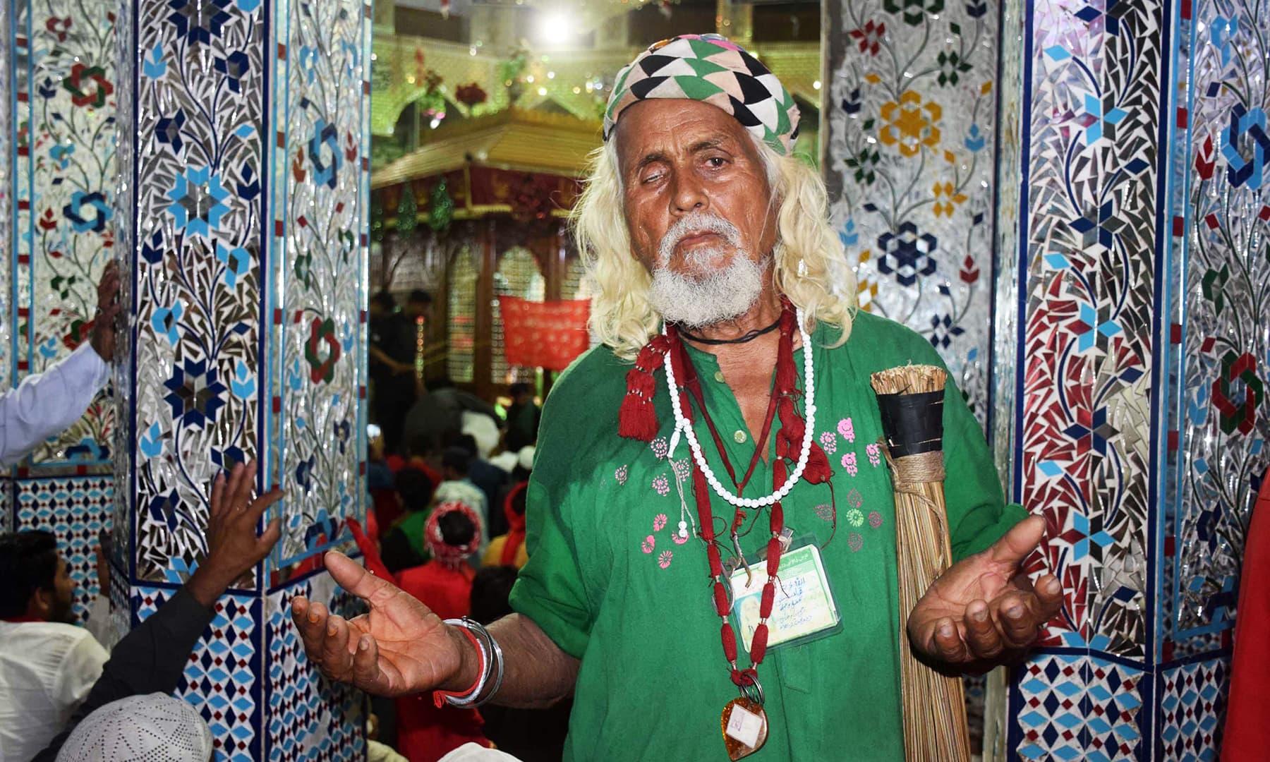 An elderly devotee prays inside the shrine.