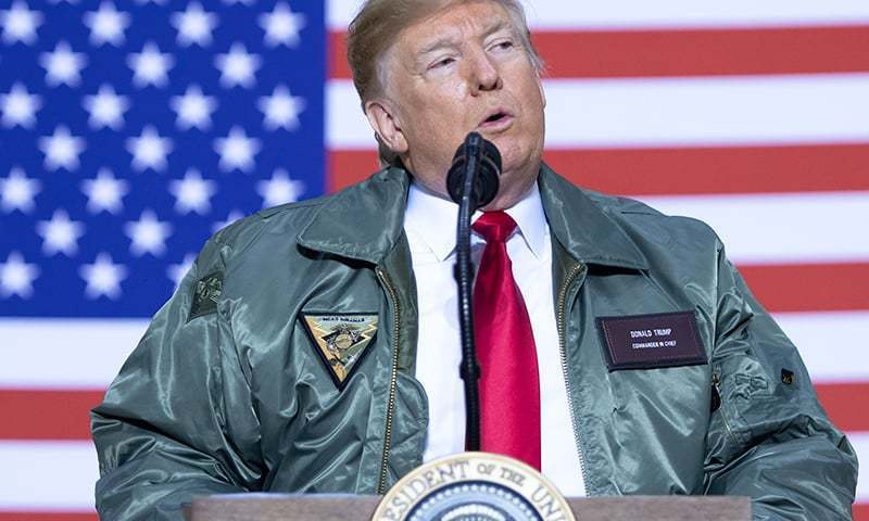 US President Donald Trump speaks to members of the US military during an unannounced trip to Al Asad Air Base in Iraq, December 26, 2018. —AFP