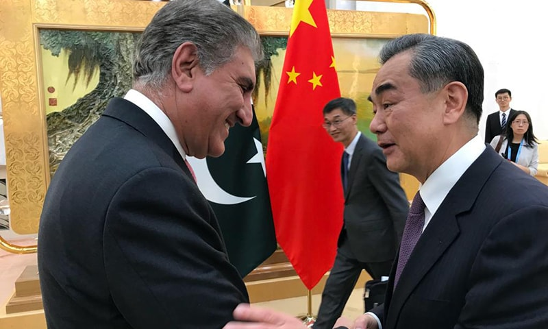 Foreign Minister of the People's Republic of China Wang Yi is pictured greeting Minister for Foreign Affairs Shah Mahmood Qureshi prior to meeting held between the two in Beijing on April 24. — Foreign Office