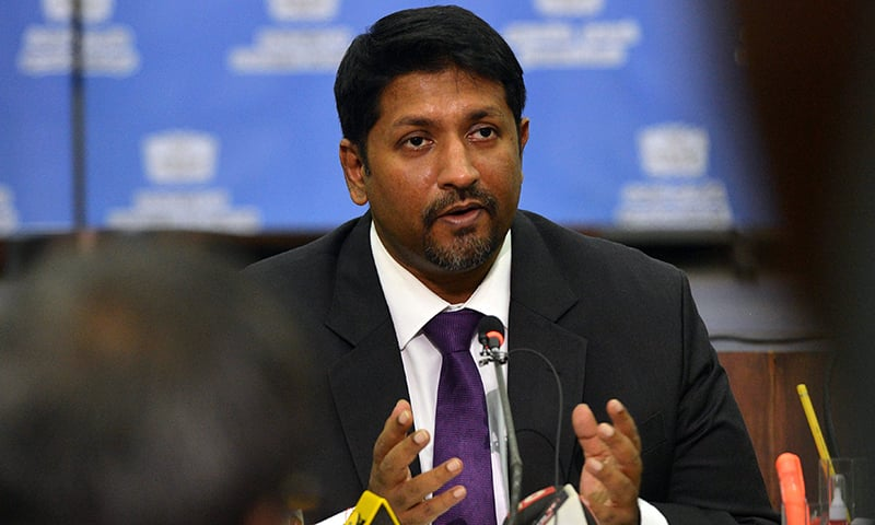 Sri Lanka's state minister of defence Ruwan Wijewardene (L) takes part in a press conference in Colombo on April 24. — AFP