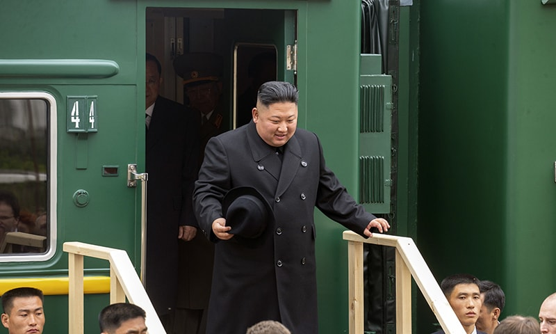 In this photo released by press office of the administration of Primorsky Krai region, North Korea's leader Kim Jong Un leaves a train carriage after arriving at the border station of Khasan, Primorsky Krai region, Russia on Wednesday, April 24, 2019. — Alexander Safronov/Press Office of the Primorye Territory Administration via AP