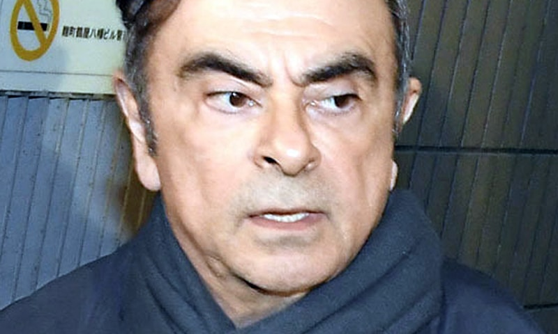 In this undated photo, former Nissan Chairman Carlos Ghosn leaves his lawyer's office in Tokyo. — AP