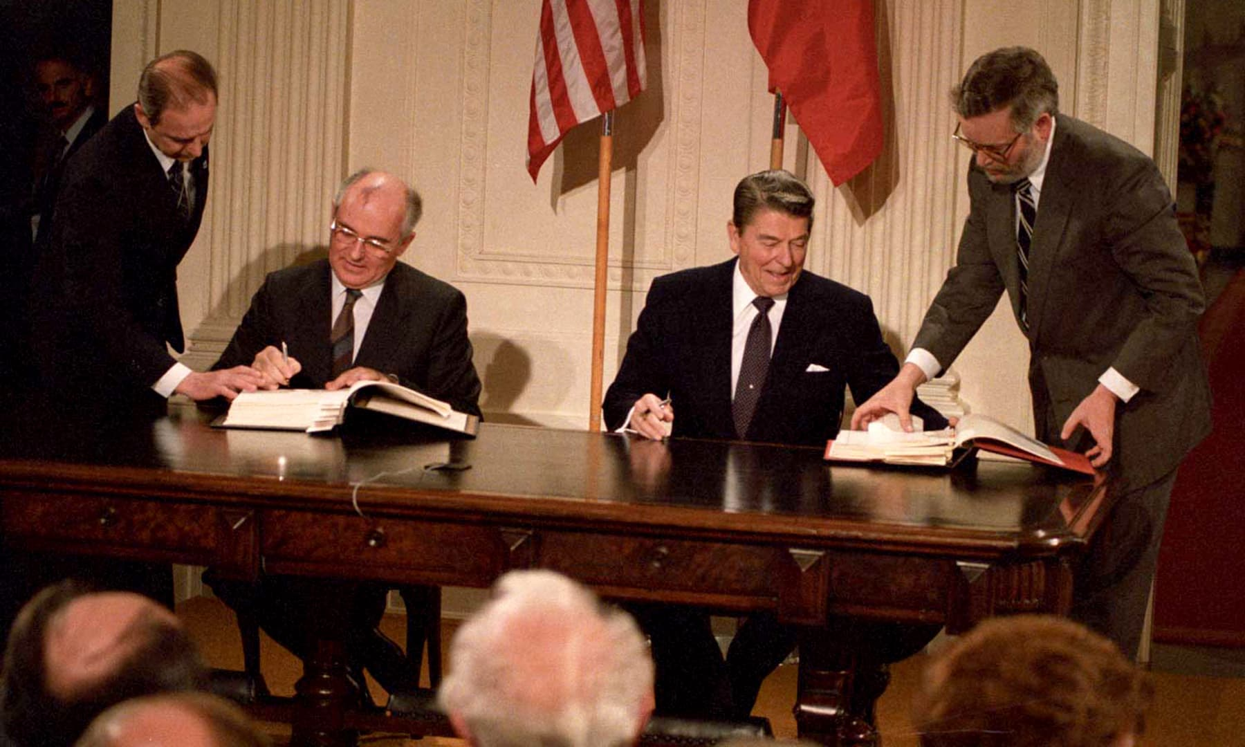 US President Ronald Reagan (right) and Soviet President Mikhail Gorbachev sign the Intermediate-Range Nuclear Forces Treaty in the White House in December 1987. The treaty, meant to limit the threat of nuclear weapons, has handed China an advantage. — Reuters