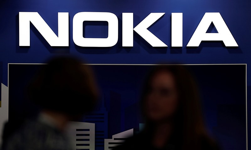 Visitors gather outside the Nokia booth at the Mobile World Congress in Barcelona, Spain, Feb 26, 2019. — Reuters