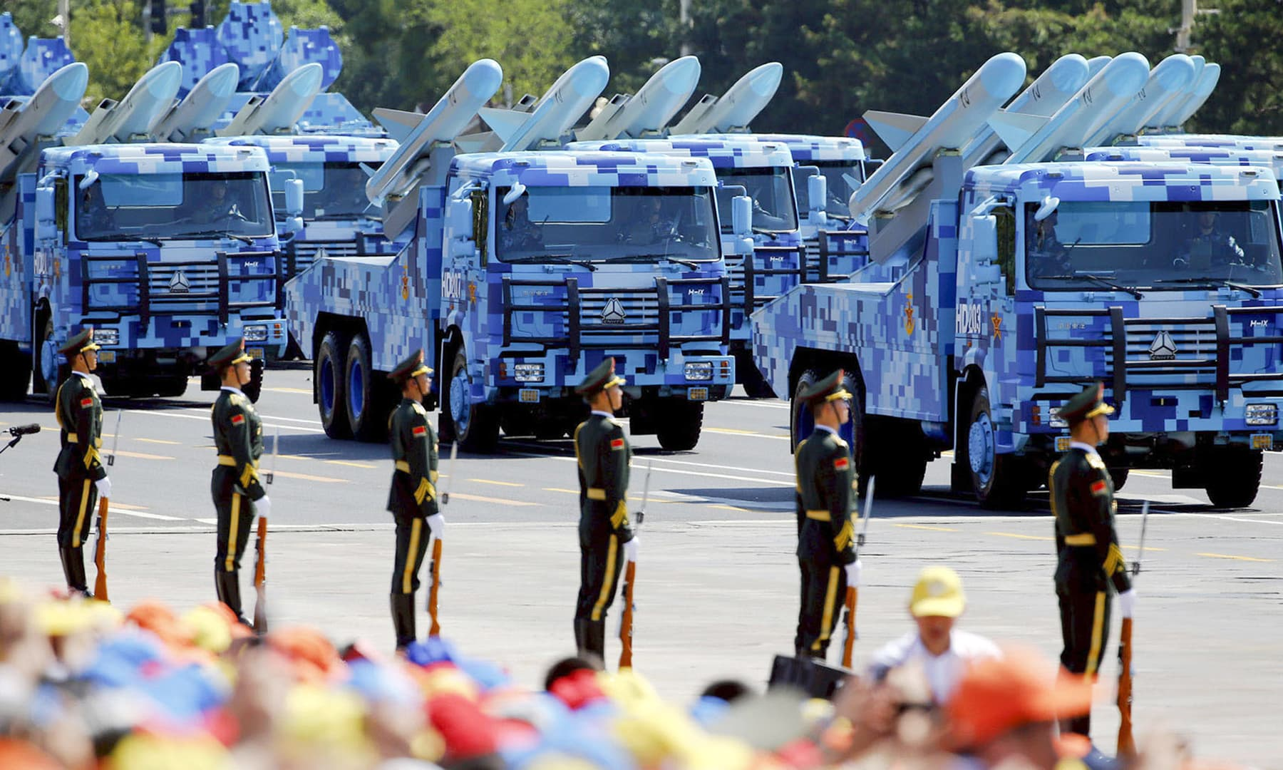 Trucks carrying anti-ship missiles roll to Beijing's Tiananmen Square during a military parade in 2015. — Reuters