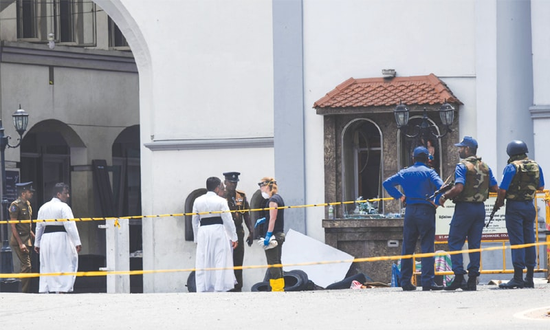 Colombo: A foreign investigator (centre) talks to priests as soldiers stand guard at  St Anthony's Shrine on Thursday.—AFP