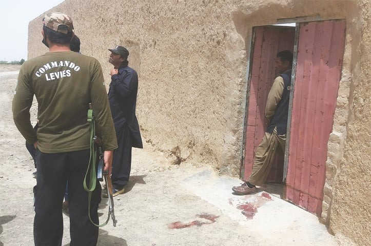 Security personnel gather at the site of an attack on a polio vaccination team in Chaman on Thursday.—AFP