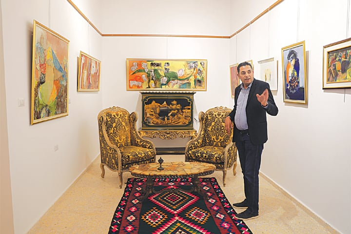 TRIPOLI: Businessman Mustafa Iskandar inside his art gallery and cultural centre.—Reuters