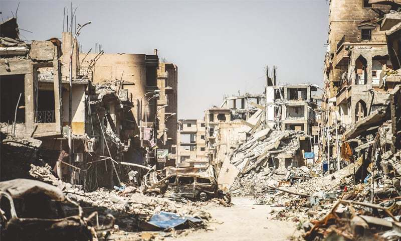 This file photo shows a general view of heavily damaged buildings in Raqqa after a Kurdish-led force expelled the militant Islamic State group from the northern Syrian city.—AFP