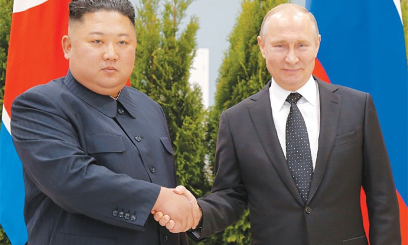VLADIVOSTOK: Russian President Vladimir Putin and North Korean leader Kim Jong-un shake hands on Thursday. — AFP