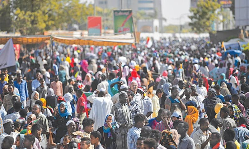 KHARTOUM: Protesters gather for a march on Thursday. — AFP