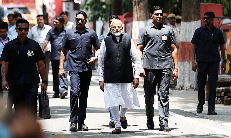 India's Prime Minister Narendra Modi arrives to file his nomination papers for the general elections in Varanasi, India. — Reuters