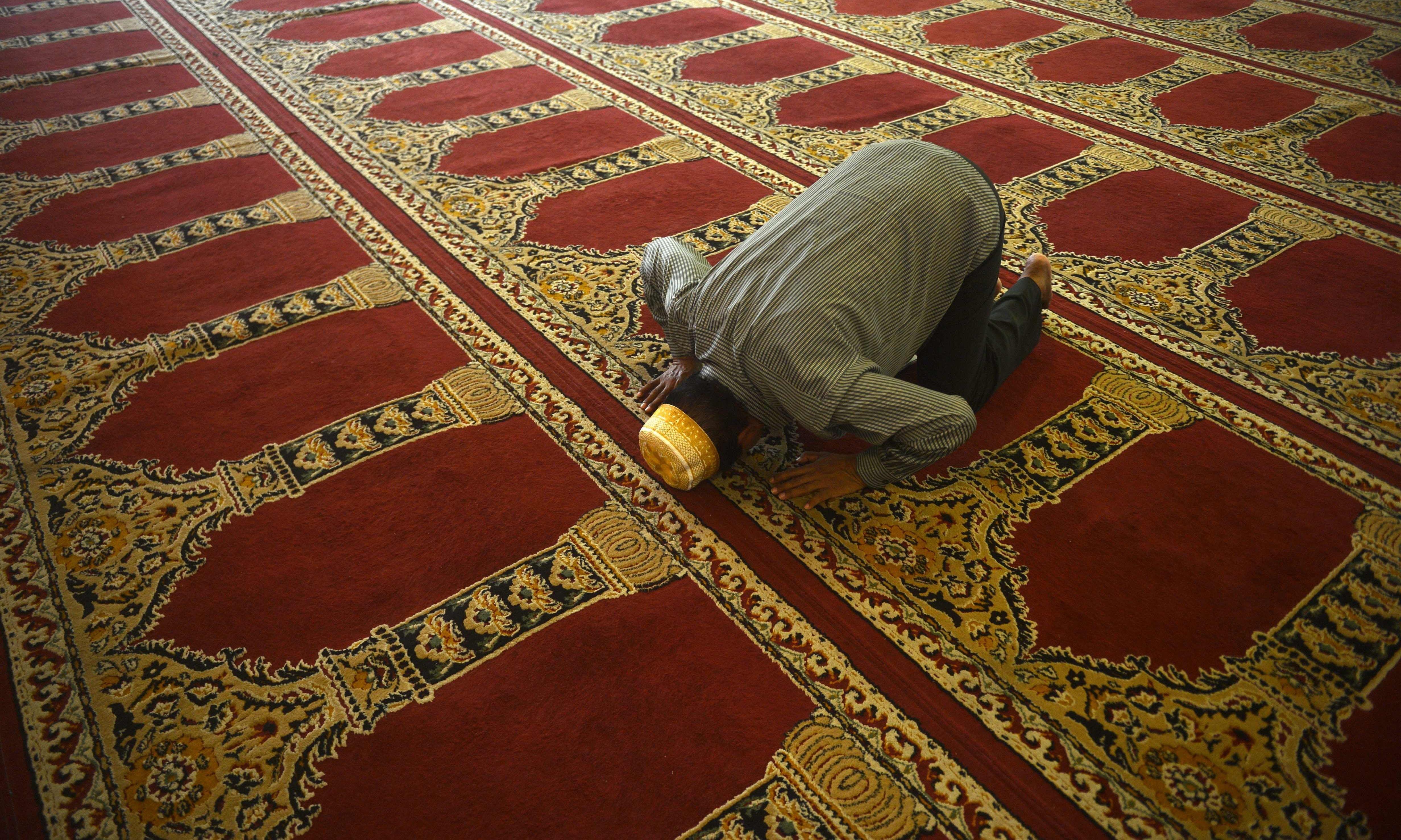 A Sri Lankan Muslim man prays at the Dawatagaha Jumma Masjid during Friday noon prayers in Colombo. — AFP
