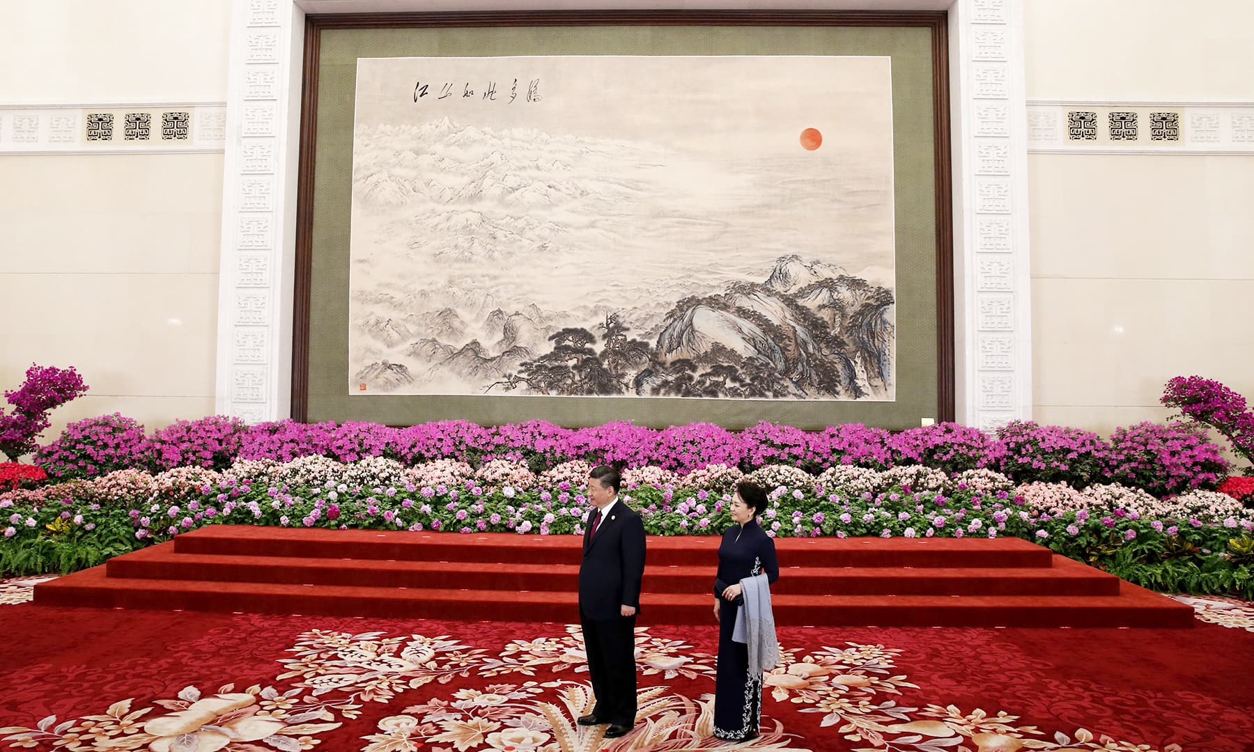Chinese President Xi Jinping (L) and his wife Peng Liyuan wait for leaders to attend a welcome banquet for the Belt and Road Forum at the Great Hall of the People in Beijing. — AFP