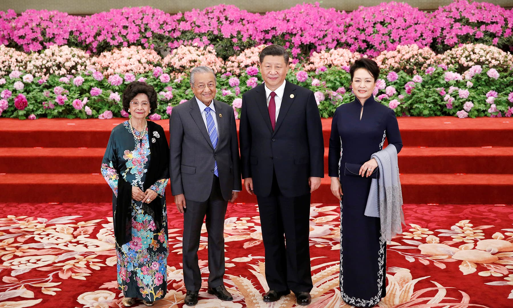 Malaysian Prime Minister Mahathir Mohamad (2nd L) and his wife Siti Hasmah arrive to attend the welcome banquet. — Reuters