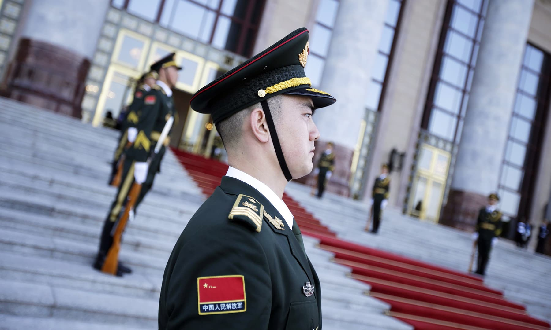 A member of the Chinese Honour Guard pictured outside the Great Hall of the People, in Beijing, before the start of the welcome banquet. — AFP