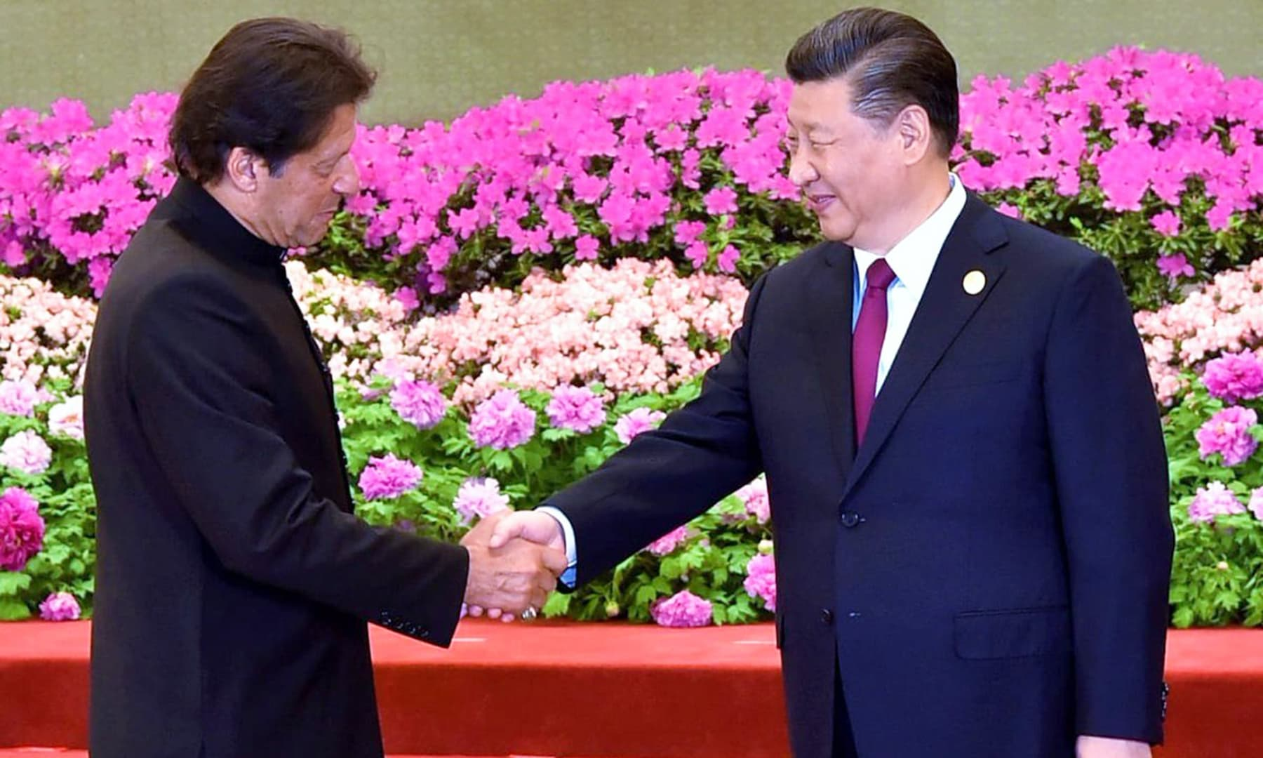 Prime Minister Imran Khan and Chinese President Xi Jinping shake hands prior to the welcome banquet at the Great Hall of the People, in Beijing. — PID