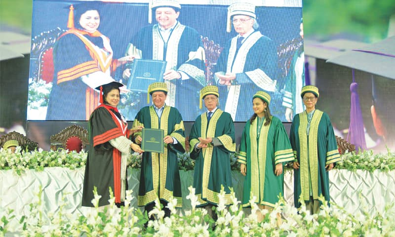 A student receives her degree from Deputy Chairman of Senate Saleem Man­dviwalla at the 16th convocation of Ziauddin Universtiy on Friday.
