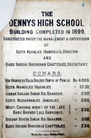 A plaque bearing the names of people who donated to build the school.