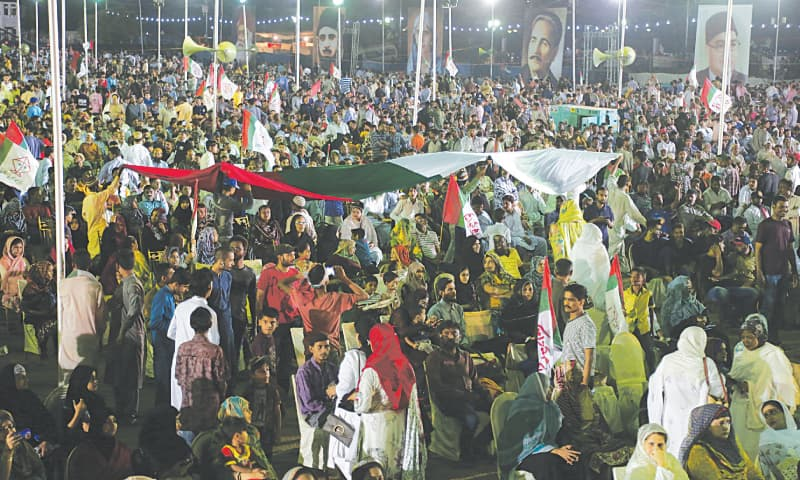 MQM supporters carry the party flag at the rally.—White Star