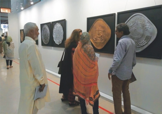 People taking interest in the exhibition