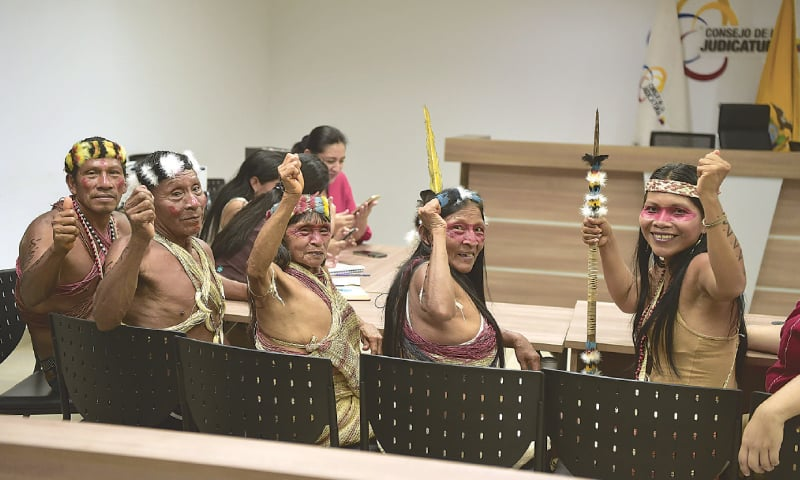 members of the Waorani community at the beginning of their hearing at a court in Puyo, Ecuador, on Friday.—AFP
