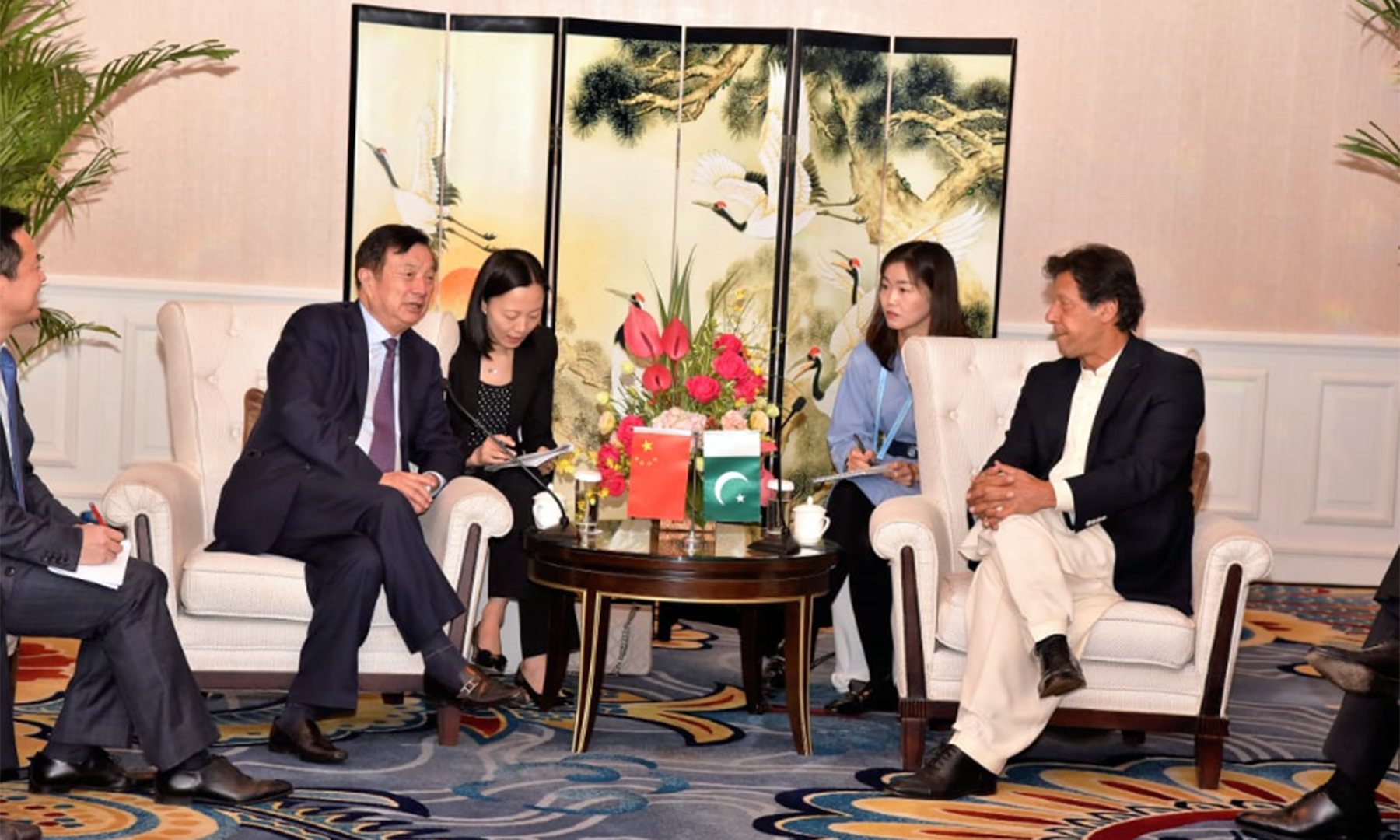 Prime Minister Imran Khan in a discussion with Huawei CEO Ren Zhengfei. — Ministry of Planning