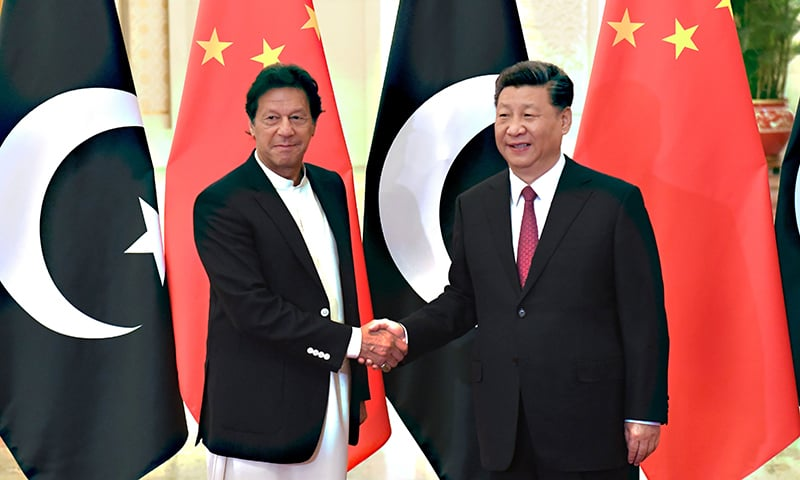 China's President Xi Jinping shakes hands with Prime Minister Imran Khan before their meeting at the Great Hall of the People in Beijing on April 28. — AFP