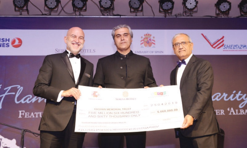 Spanish Ambassador Manuel Duran Gilmour Rico and Serena Hotels CEO Aziz Boolani present a cheque to Kaghan Memorial Trust Director Khurram Khan.