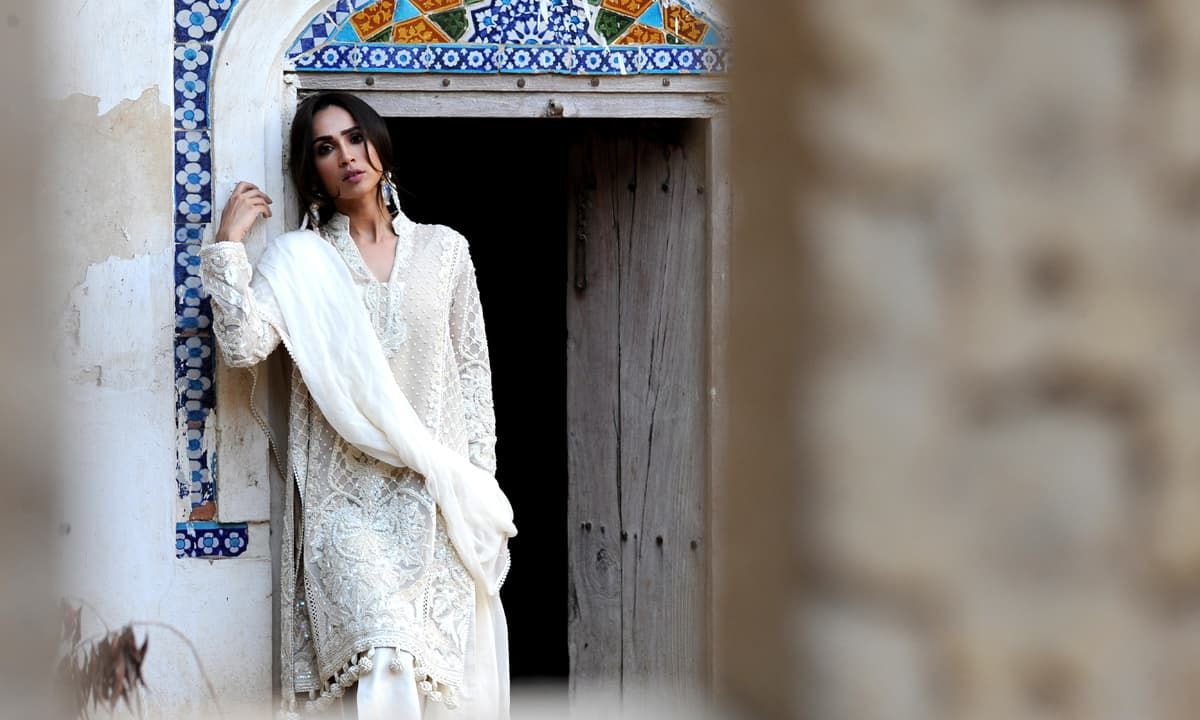 The elegant white kurta by Rizwan Beyg, worked with minute artisanal embroideries | Photos by Arif Mahmood