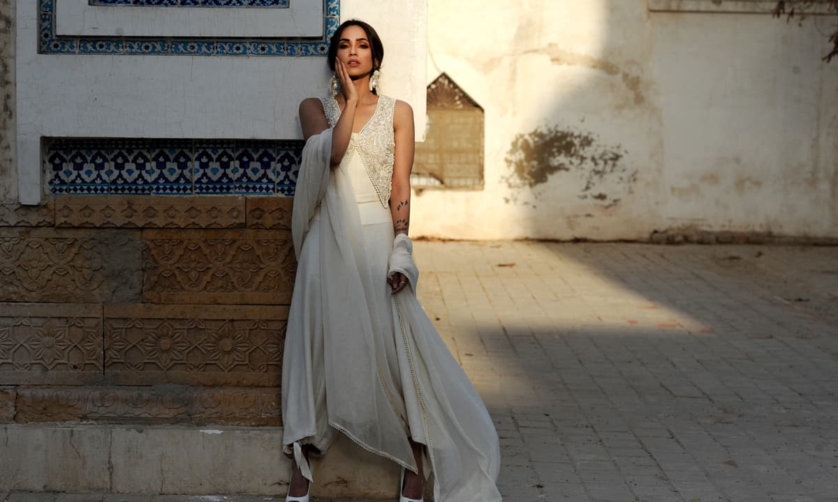 The fitted embroidered bodice paired with a modern flowy trouser is both minimalist and contemporary.
