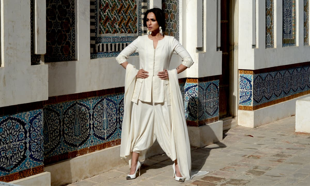 Statement-wear that is timeless: the hybrid of a harem trouser and a shalwar, paired with a tailored button-down shirt that has embroidered , exaggerated pockets.