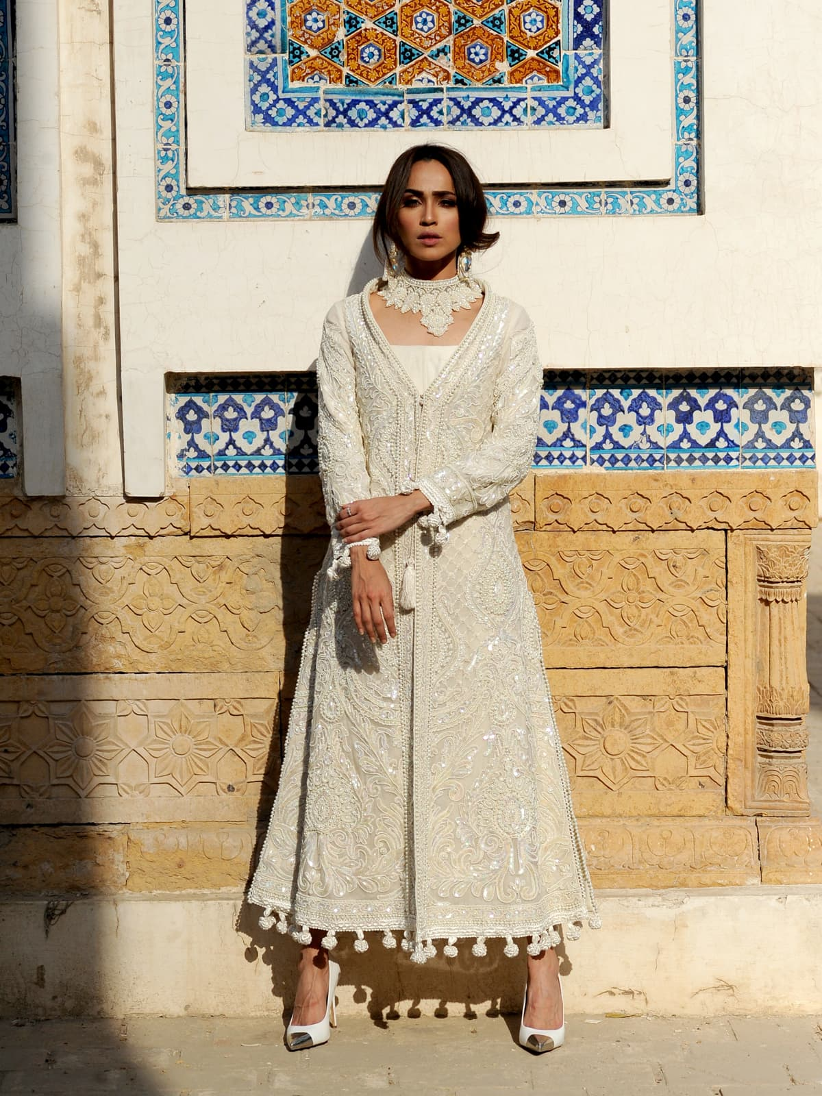 Classically Pakistani and yet universal in its beauty; thread embroideries, pearls and sequins shimmer on a design that is reflective of Rizwan Beyg's creative brilliance – and of the exquisite indigenous craft found within Pakistan.
