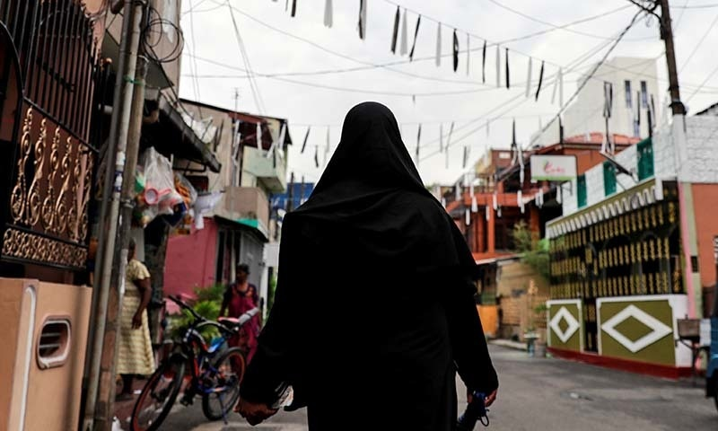 A woman wearing a hijab walks through a street near St Anthony's Shrine, days after a string of suicide bomb attacks across the island on Easter Sunday, in Colombo, Sri Lanka on April 29, 2019. — Reuters/Danish Siddiqui