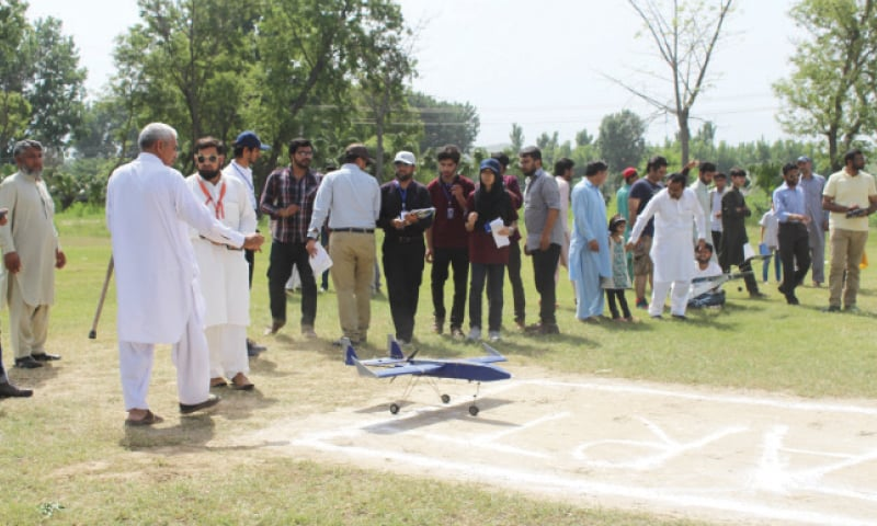 A model aircraft is ready for take off during the competition at Ghulam Ishaq Khan Institute on Monday. — Dawn