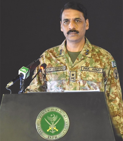 Inter-Services Public Relations Director General Maj Gen Asif Ghafoor addressing a press conference at the General Headquarters on Monday.—INP