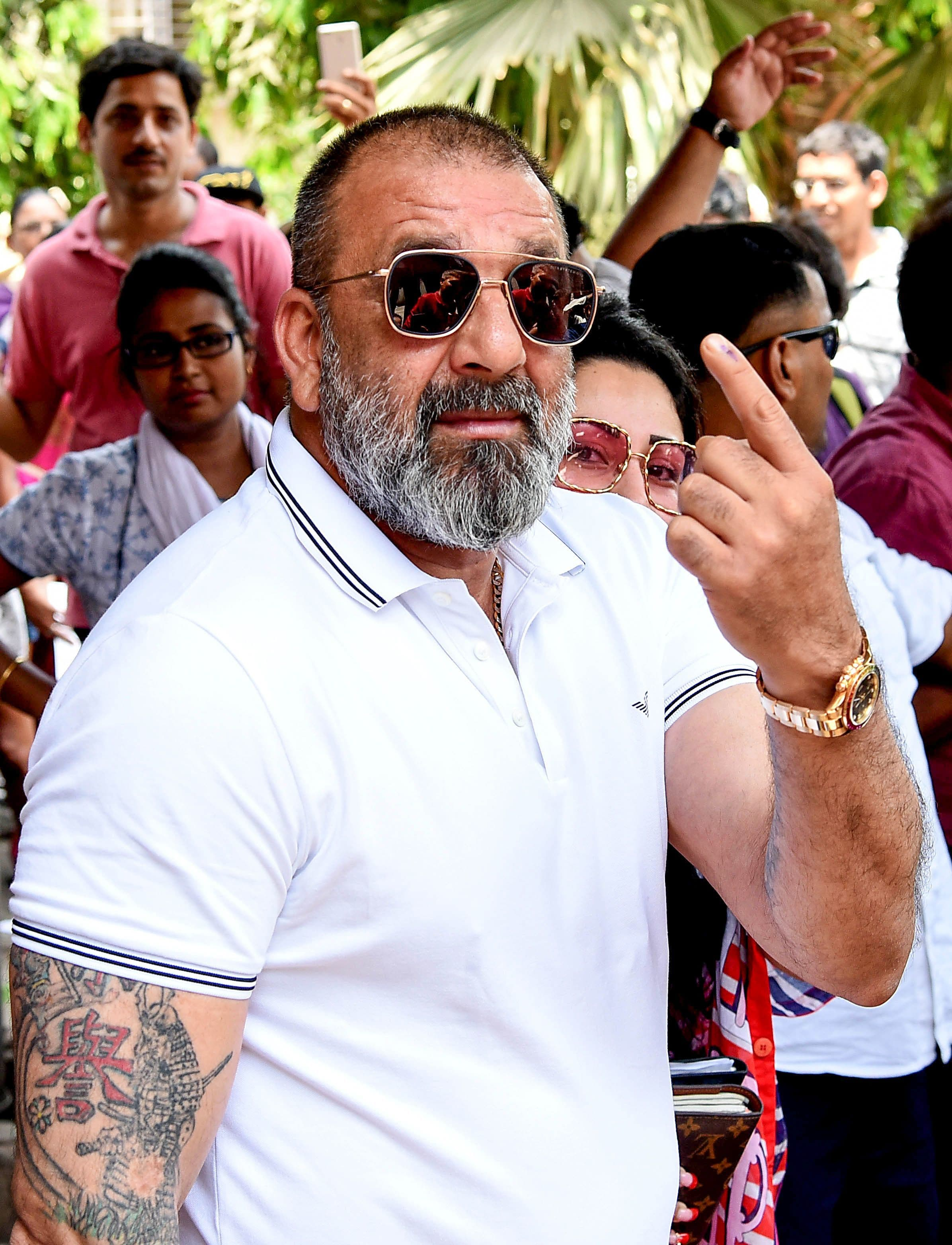 Bollywood actor Sanjay Dutt poses for photographs after casting his vote at a polling station in Mumbai on April 29, 2019. — AFP