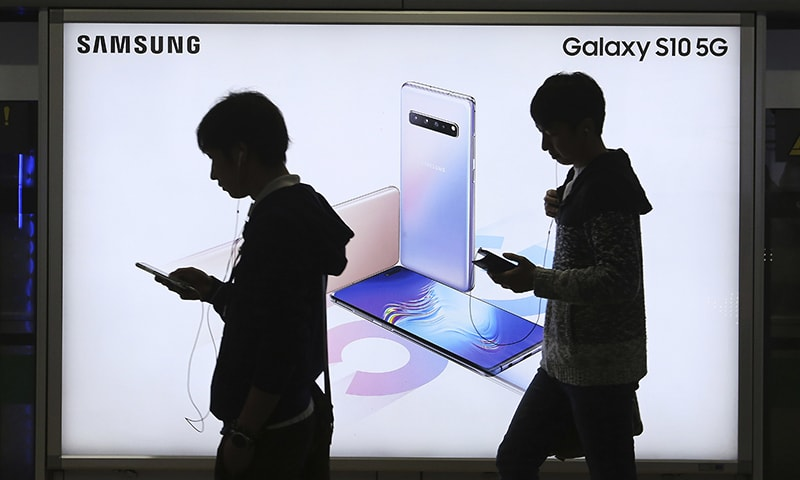 People pass by an advertisement of Samsung Electronics' Galaxy S10 5G smartphone at a subway station in Seoul, South Korea. — AP