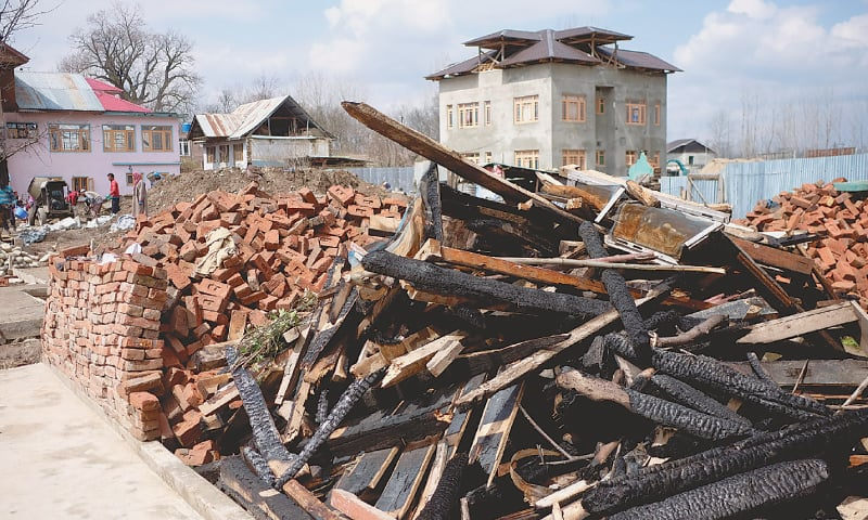 THE debris of a house destroyed during a gun battle between local fighters and Indian troops is seen in Pinglan village in India-held Kashmir.—Reuters