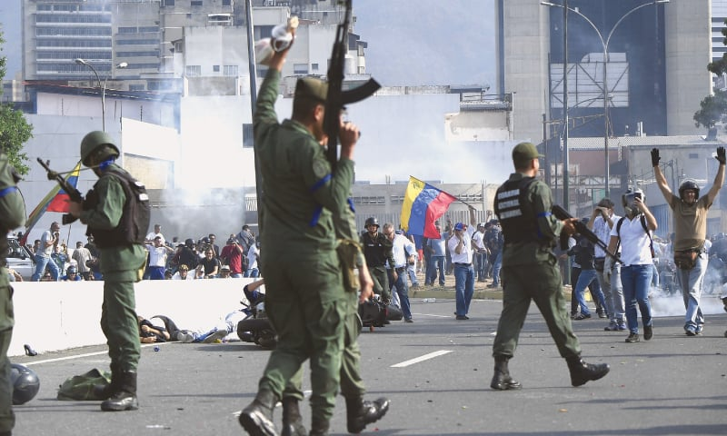Caracas: Members of Bolivia's National Guard, who joined Venezuelan opposition leader Juan Guaido, jubilant after repelling an attempt by soldiers loyal to President Nicolas Maduro to disperse a demonstration near a military base on Tuesday. — AFP