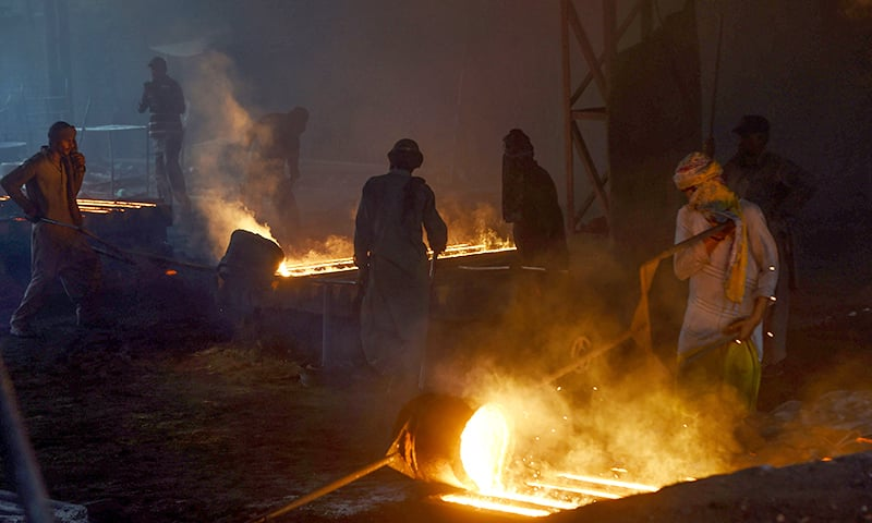 Labourers work at an iron factory in Lahore on April 30, 2019, on the eve of International Labour Day celebrated on May 1. ─ AFP