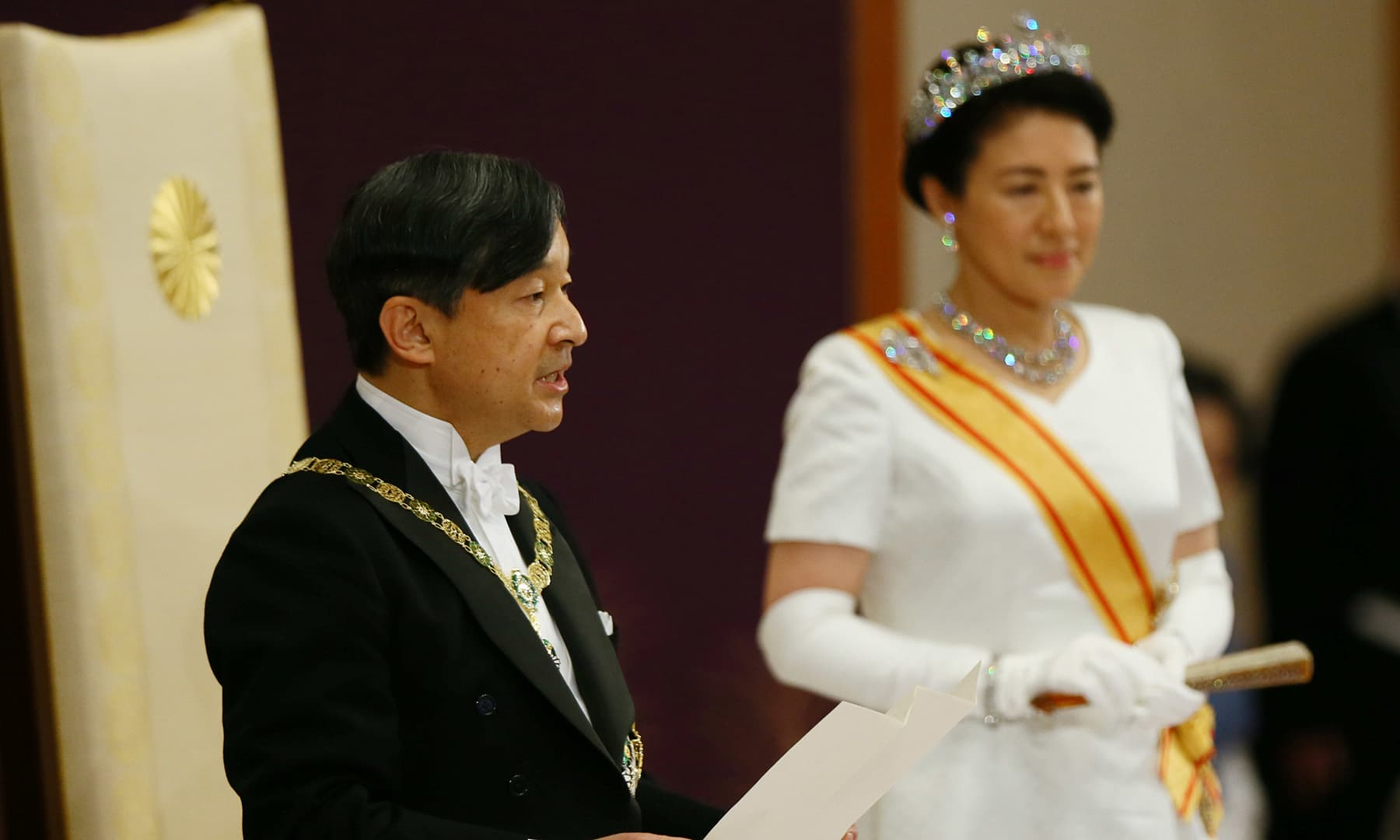 Japan's Emperor Naruhito, flanked by Empress Masako, delivers a speech during a ceremony called Sokui-go-Choken-no-gi, his first audience after the accession to the throne, at the Imperial Palace in Tokyo. — Reuters