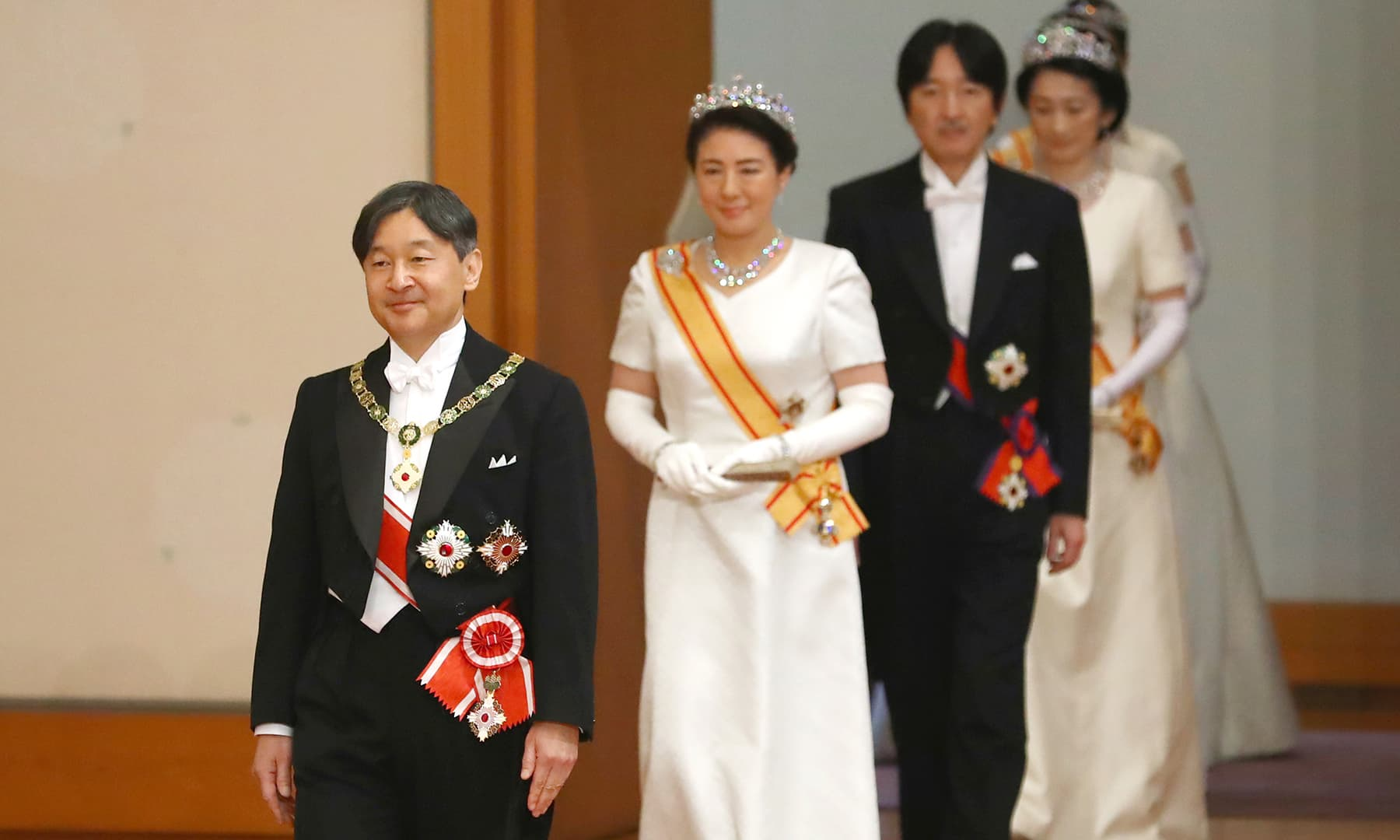 Japan's new Emperor Naruhito, followed by new Empress Masako, Crown Prince and Crown Princess Akishino, walks to make his first address during a ritual after succeeding his father Akihito at Imperial Palace in Tokyo. — AP