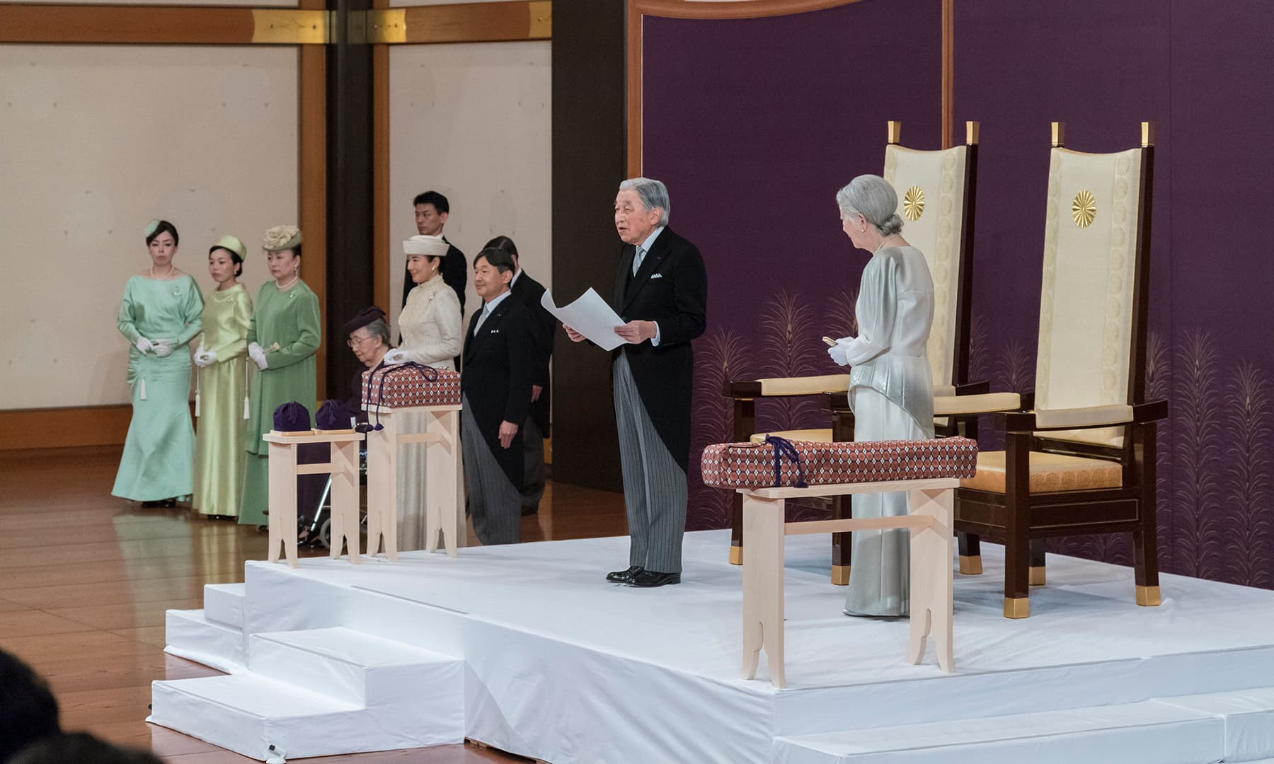 This handout photo taken and released by Japan's Imperial Household Agency on April 30, 2019 shows Japan's Emperor Akihito (C) speaking during his abdication ceremony in front of other members of the royal family and top government officials at the Imperial Palace in Tokyo, as Empress Michiko (R) looks on. — AFP