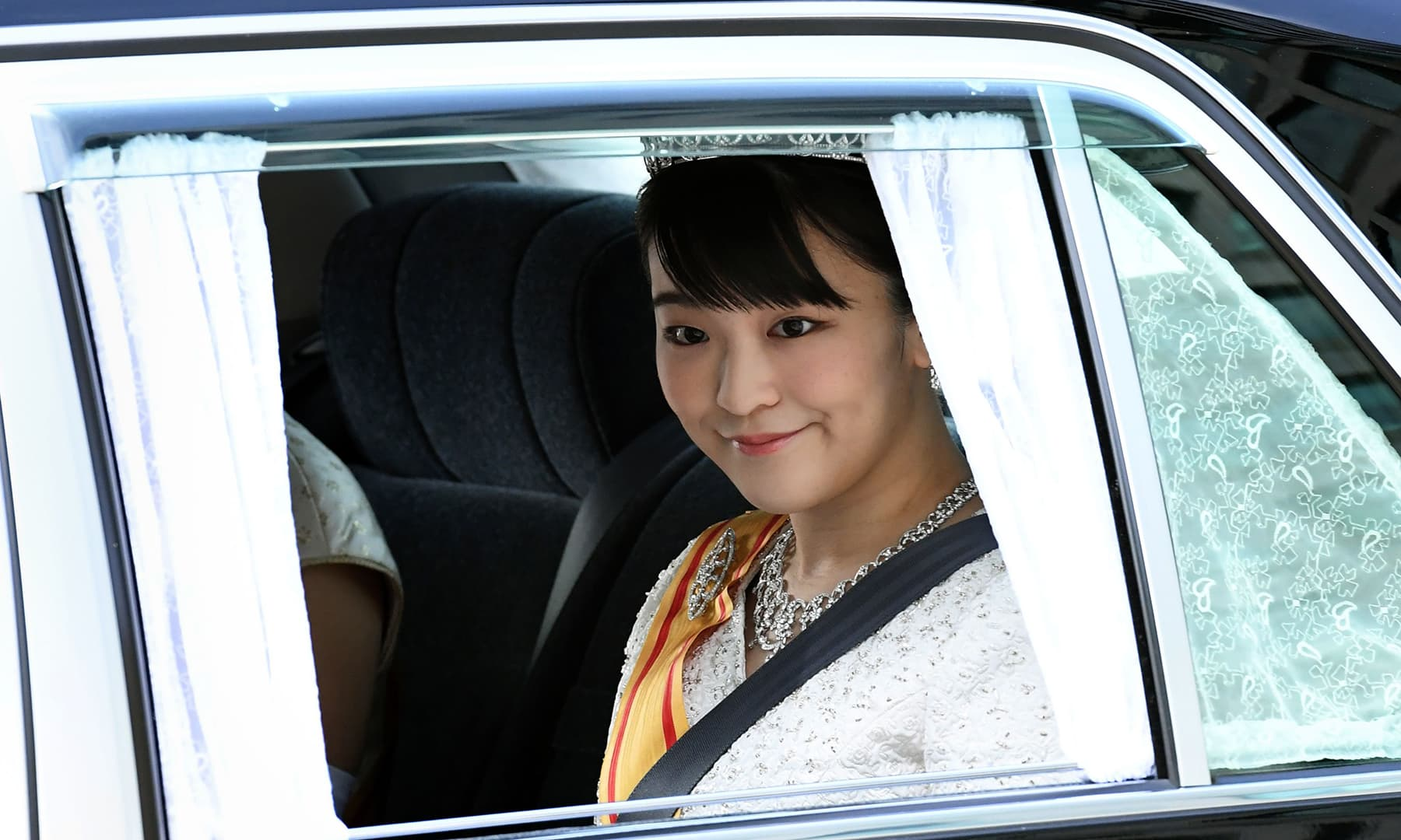 A vehicle carrying Japan's Princess Mako, daughter of Crown Prince Akishino, arrives at the Imperial Palace in Tokyo. — AFP
