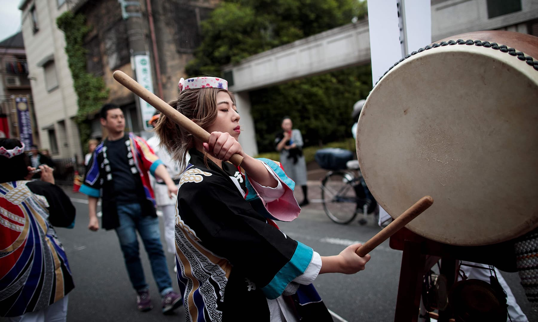 A woman plays a drum during a ceremony to celebrate the accession of the new emperor to the throne in the Nakanobu neighbourhood of Tokyo on May 1, 2019. — AFP
