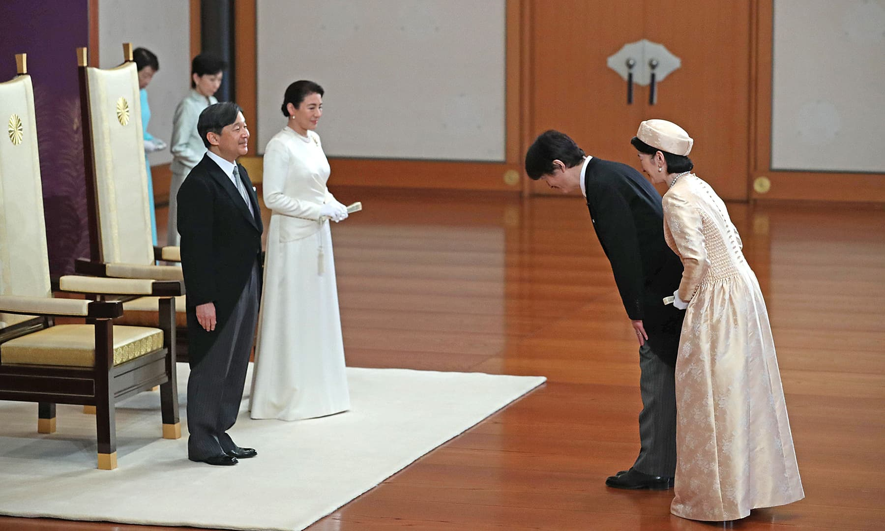 Japan's new Emperor Naruhito (L) and Empress Masako (2nd L) listen to congratulatory words from Crown Prince Akishino (2nd R) and Crown Princess Kiko (R) during an event to receive a celebration of the accession to the throne at the Imperial Palace in Tokyo on May 1, 2019. — AFP