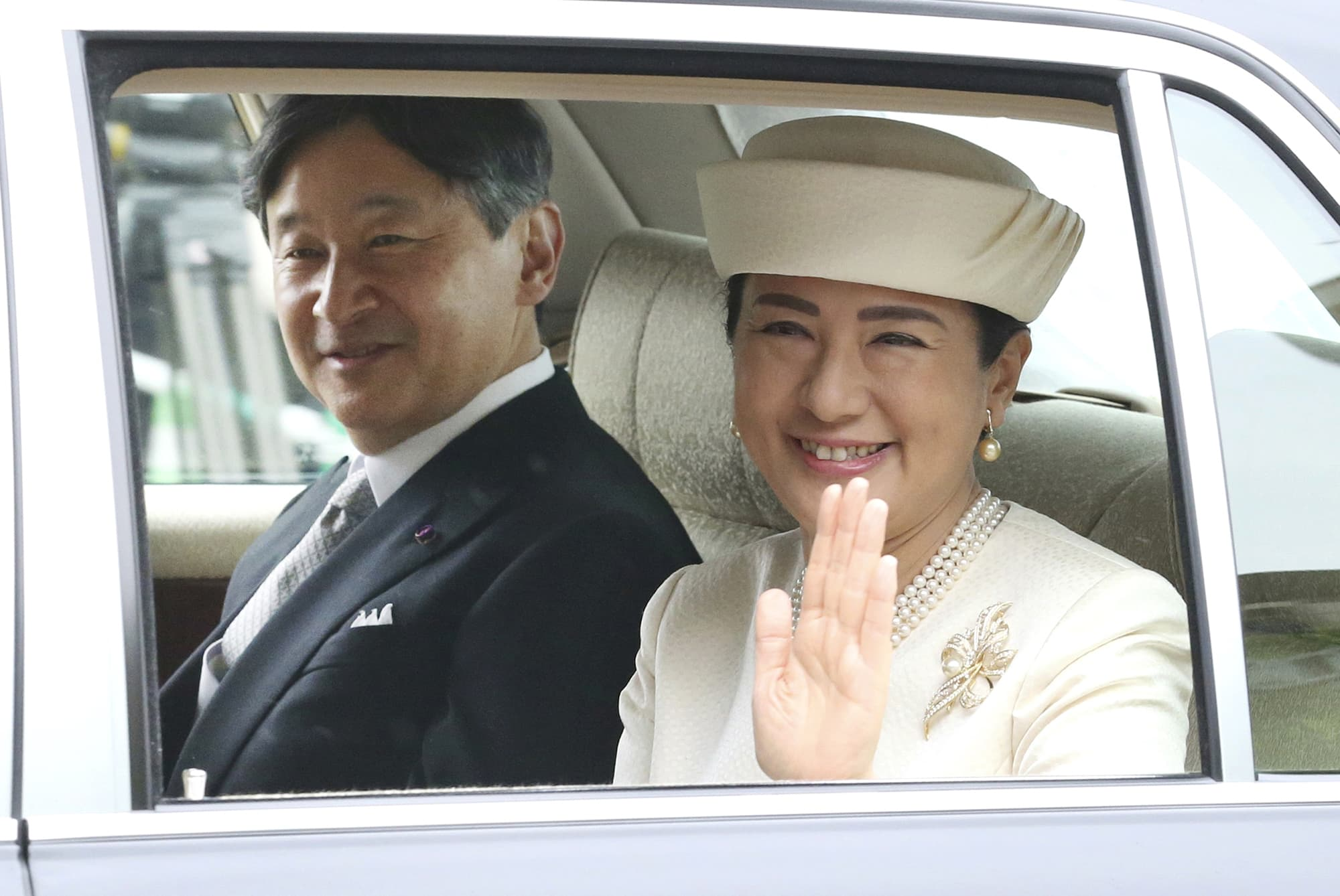 Japan's new Emperor Naruhito and new Empress Masako are driven to Imperial Palace to greet Emperor Emeritus Akihito and Empress Emerita Michiko in Tokyo. — AP