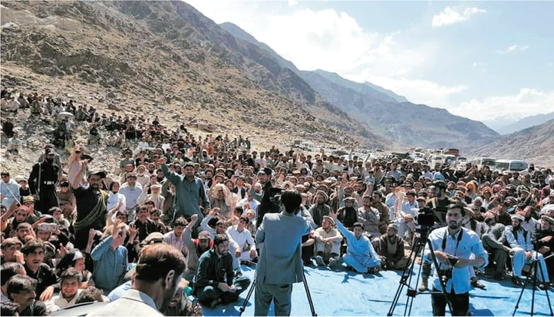 Protesters block Karakoram Highway at Basari in Diamer on Wednesday. — Dawn